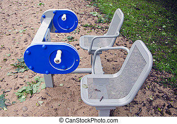 Two seats with playground equipment
