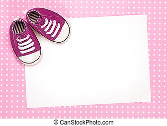 Blank card with pink baby shoes and space for copy