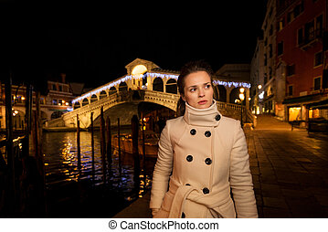 Elegant young woman. Rialto. Christmas time in Venice, Italy...