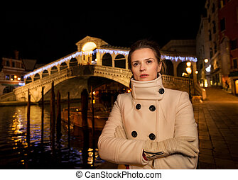 Woman in white coat. Rialto. Christmas time in Venice, Italy...