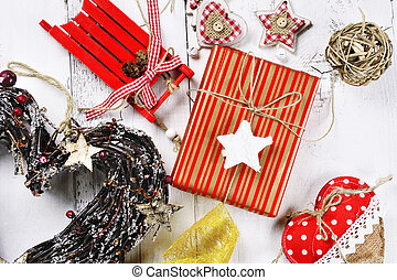 christmas wreath, sled, decorations on wooden background -...