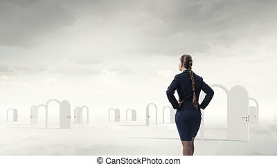 Door to new opportunity - Businesswoman standing in front of...