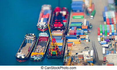 Cargo ships with containers at port terminal Hong Kong Tilt...