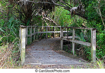 a long wooden boardwalk bridge Sanibel Florida