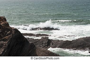 water splah on the rocks - water splashing on the rocks at...