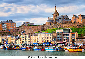 Gothic church on the hill and fishermen boats in port town...
