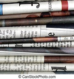 Newspapers - Detail of a stack of international newspapers