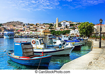 traditional island of Greece - Chalki . with old fishing boats