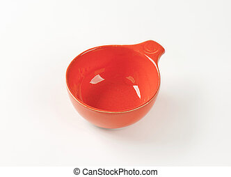 Red glazed ceramic cup or soup bowl