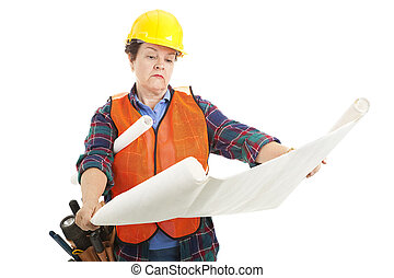 Construction Worker Reads Plans
