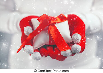Woman offering Christmas gift in wrapped box - Woman giving...