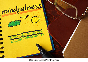 mindfulness - Notebook with mindfulness  sign on a table.