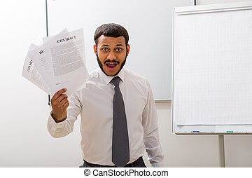 Clerk with contracts.
