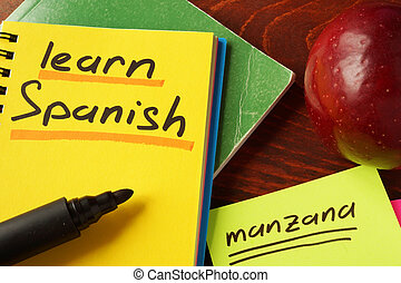 learn Spanish - Notebook with learn Spanish sign on a table....