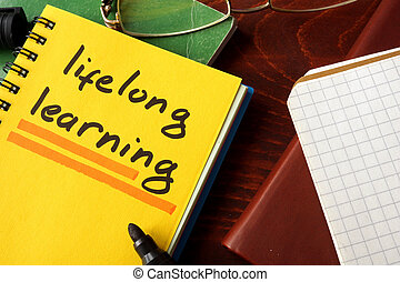 lifelong learning - Notebook with lifelong learning sign on...
