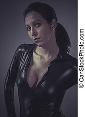 Leadership, brunette woman wearing black latex