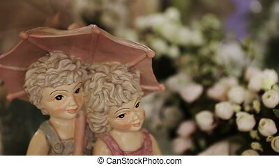Boy and Girl Under Umbrella - Statuette of a boy and girl...