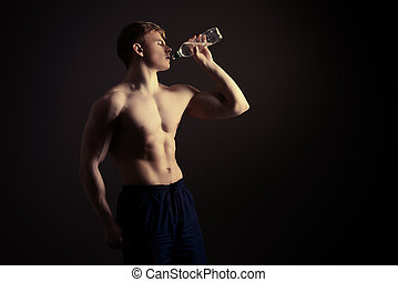 clear water - Athletic man drinking clear water after...