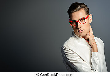eyewear - Modern young man in white jacket and elegant red...