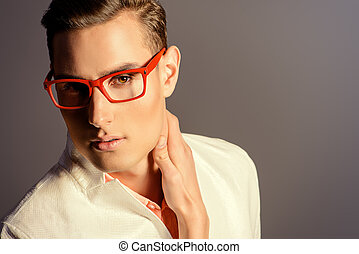 spectacles - Modern young man in white jacket and elegant...