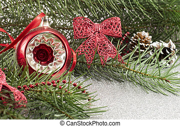 Christmas ornament and fir tree on shiny background
