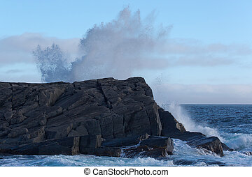 Waves breaking on rock formation - Waves breaking on the...