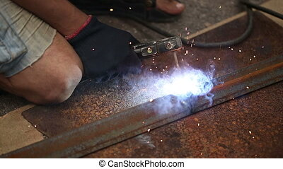 Worker Welding Metal Constructions - Worker on a plant...