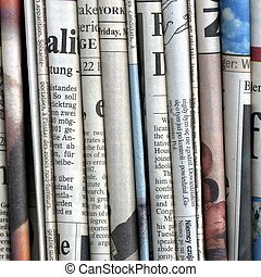 Newspapers - Stack of international newspapers