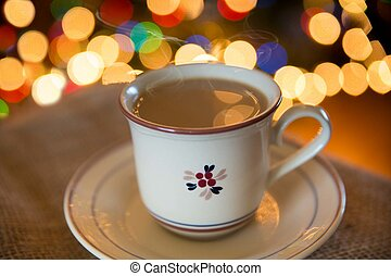 Christmas Coffee - Cup of coffee in cozy setting with lights...