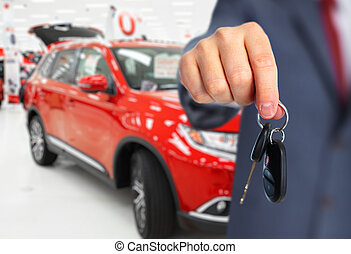 Car dealer hand with a key. - Car dealer with a key. Auto...