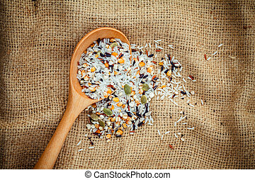 Mixed multi grain traditional thai rice ,corn ,sunflower ,rye ,sesame , and Job's tears best food for healthy and clean food on hemp sacks background.