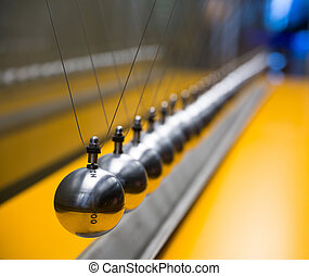 Newton's cradle balancing large group of balls