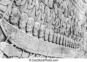 Stone carving in Angkor Thom - Stone carved faces in boat in...