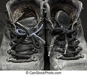 Old worn out shoes - Old black worn out shoes closeup