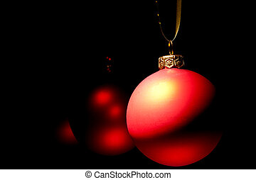 Hanging Christmas red baubles in dark