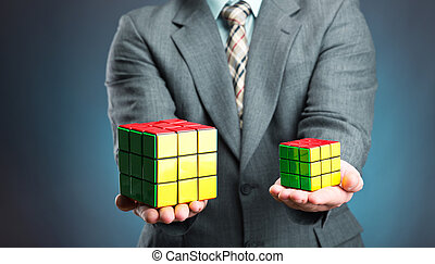 Businessman holding cube in his hands, closeup picture