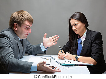 Contract - Two young caucasian office worker discussing...