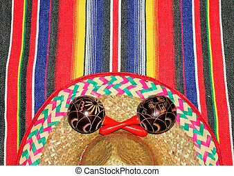Mexico maracas poncho sombrero serape background