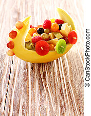 Colorful healthy fresh fruit salad in a boat - Colorful...