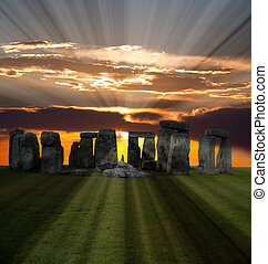 The famous Stonehenge in England on a sunrise background
