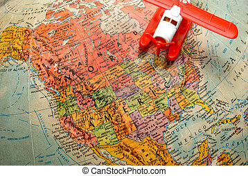 World Travel - A toy airplane flying over a globe