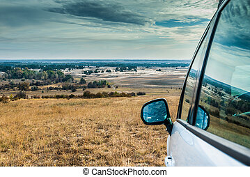 car on the background of Kharkov desert in autumn, Ukraine
