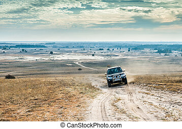 jeep on Kharkov desert background - jeep on autumn Kharkov...