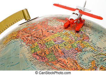 World Travel - A toy palne flying over a globe.