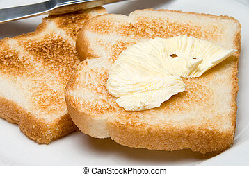 Buttered Toast - A pat of butter on freshly made toast