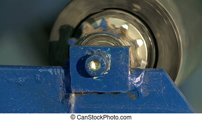 Close-up of rotating cylinder on production machine