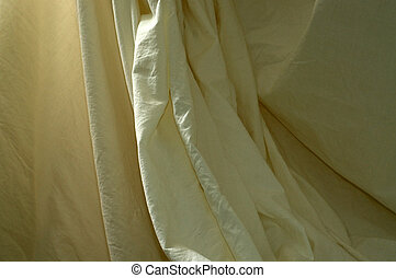 draped muslin background cloth with folds - A neutral off...
