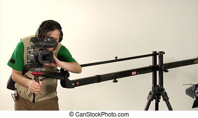 studio video shooting - cameraman shooting in studio with...