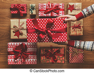 Woman organising beautifuly wrapped vintage christmas...