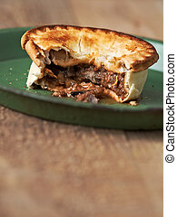 rustic meat and mushroom pie - close up of rustic meat and...